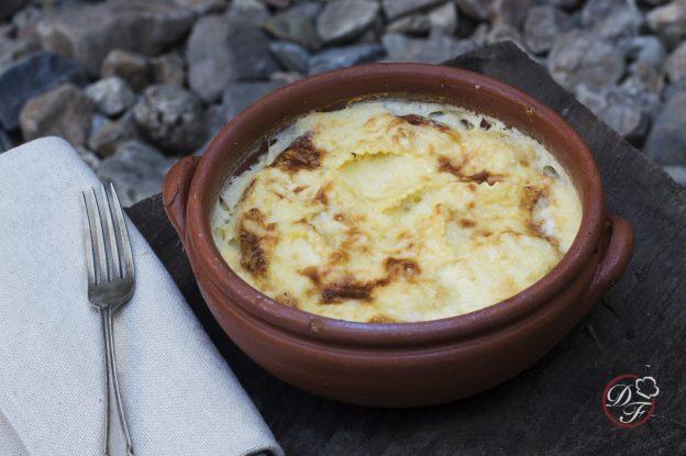 ravioles gratinados con salsa de queso